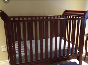 Solid wood crib with underneath storage