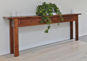 Brown wooden console table with three drawers