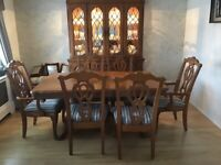 Solid wood dining table, chairs and glass unit