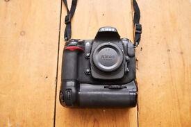 Nikon D300 DSLR camera body + battery grip