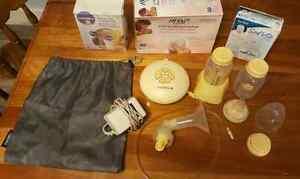 Medela Swing Breast Pump (including breast pads & storage bags)