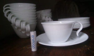 14 white Corelle teacups and saucers