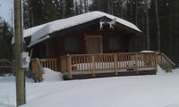 LOG CABIN ON 8 ACRES AT CLUCULZ LAKE FOR SALE