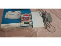 Wii u console with wii u party and wii remote no gamepad but boxed and full working order