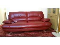 Red leather sofa and storage puff
