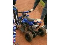 49cc kids petrol quad with helmet and suit