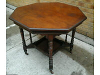 Edwardian octagonal oak table on casters
