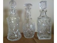 Set of three matching crystal decanters and crystal basket