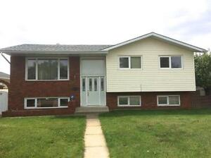 Bi-Level with Nanny Suite, Hardwood and Double Heated Garage!