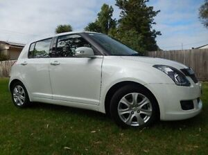 2010 Suzuki Swift RS415 RE4 White 5 Speed Manual Hatchback Doveton Casey Area Preview