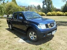 2010 Nissan Navara D40 ST Blue 6 Speed Manual Utility Derwent Park Glenorchy Area Preview