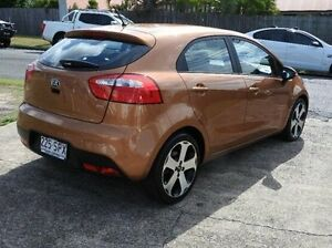 2012 Kia Rio UB MY12 SLi Brown 6 Speed Manual Hatchback Morningside Brisbane South East Preview