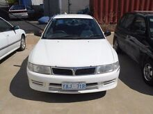 1998 Mitsubishi Lancer CE II GLXi White 5 Speed Manual Sedan Fyshwick South Canberra Preview