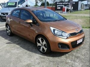 2012 Kia Rio UB MY13 SLi Brown 6 Speed Manual Hatchback Wynnum Brisbane South East Preview