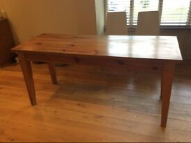 Dining table, solid pine, with drawer and tapered legs.