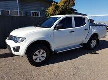 2013 Mitsubishi Triton MN MY13 GLX (4x4) White 5 Speed Manual 4x4 Dual Cab Utility Taylors Beach Port Stephens Area Preview