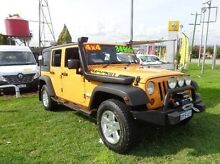 2012 Jeep Wrangler JK MY2012 Unlimited Sport Orange 6 Speed Manual Softtop Willagee Melville Area Preview