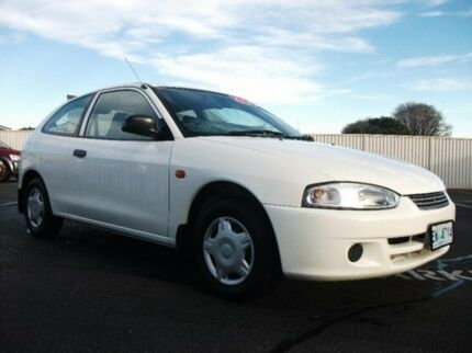 2003 Mitsubishi Mirage CE MY2002 Scotia White 5 Speed Manual Hatchback Invermay Launceston Area Preview