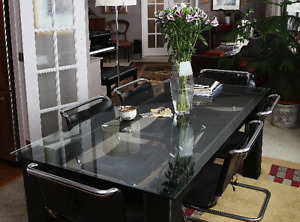 Custom-built glass top table w 6 chrome/leather chairs