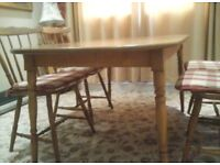 Pine dining table with four chairs