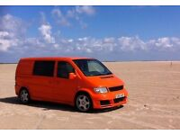 Bright orange campervan with loads of extras, ideal for city living and weekend adventures