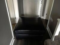 black leather sofas ones a large club chair +very large footstool .sell or swap