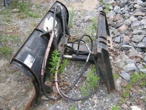 Plow to attach to a Bobcat