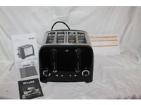 Boxed Dualit 4-slot Lite Toaster in Black Gloss/Silver. As new.