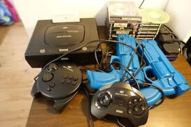 Sega Saturn with 9 games, including Nights with 3D control pad, memory module