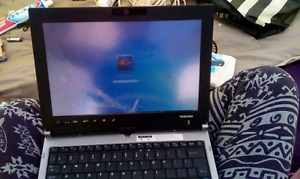 Broken screen marker on top toshiba laptop