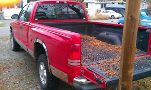 RED 2000 Dodge Dakota Pickup Truck and 2001 blue parts truck