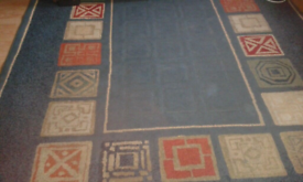 Rug size approx 9 ft by 6 ft.