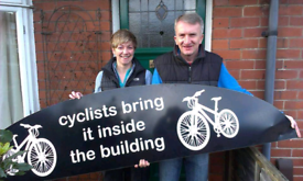 Business/Shop wall sign - 'cyclists bring it inside the building'