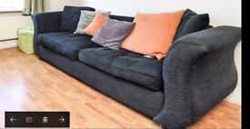 Large black upholster sofa with scatter cushions - good condition
