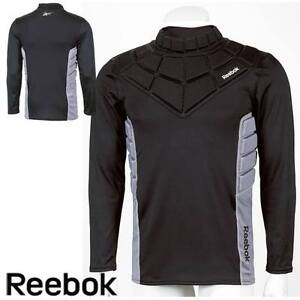 REEBOK GOALIE PADDED SHIRT- JR new with tags.Medium