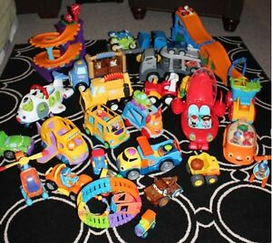 HUGE Lot of trucks and assorted toys