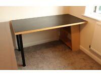 Black office desk with bookshelf