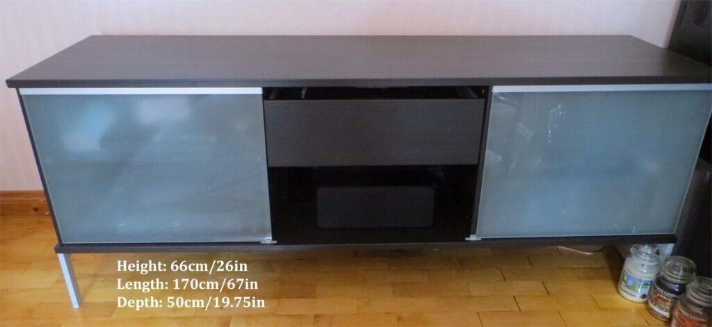 TV Cabinet black, large, will house multiple media or gaming consolesin Carrickfergus, County AntrimGumtree - Good condition, acres of room for all kinds of modern play stuff that I wouldnt be able to work nor wire up 2 sliding glass doors [manually operated not automated nor revolving nor voice activated] 1 drawer 2 glass shelves. Adjustable [manually] to 8...