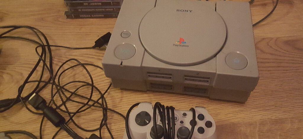2 x playstation 1 couple of games