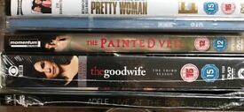 23 used and 6 new DVD's. All genres