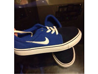 Size 1 boys Nike trainers excellent condition