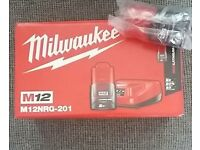 Milwaukee m12 charger and battery plus 1 extra battery
