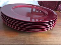 Red plastic place mat plates