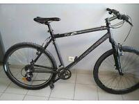 Decathlon Rockrider 5.2, 21 inch frame, 24 speed mountain bike with front suspension.