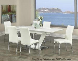 Awesome White chrome table accented by 3 choices of side chairs