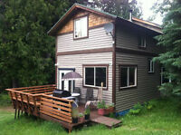 Mountain Cottage Getaway above Slocan Lake for Spring Rentals.