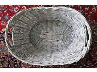 light grey wicker basket with handles