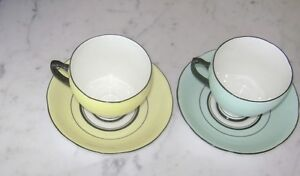TWO CUPS & SAUCERS