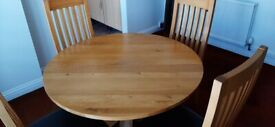 Oak dining table and chairs.
