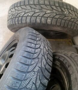 Mint set of Winter tires 215/60R17 on rims off Rogue